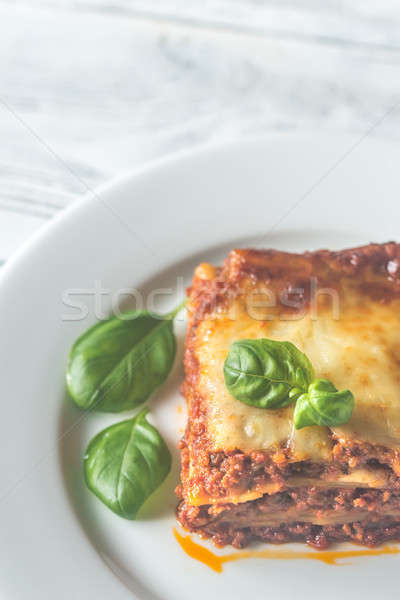 Portion of lasagne on the wooden table Stock photo © Alex9500