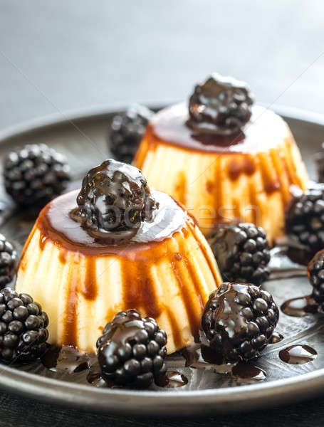 Vanilla puddings with fresh blackberries and berry topping Stock photo © Alex9500