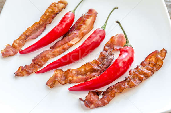 Fried bacon strips with chili pepper Stock photo © Alex9500