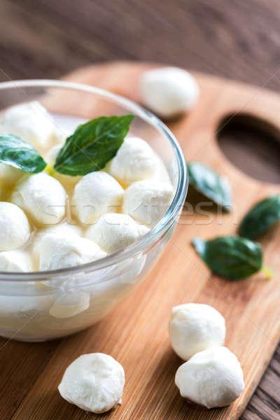 Bowl of Bocconcini mozzarella with fresh basil Stock photo © Alex9500