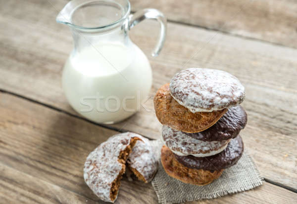 Glazed gingerbread cakes with pitcher of milk Stock photo © Alex9500