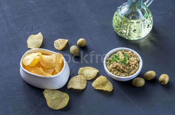 картофельные чипсы оливкового таблице черный жира обед Сток-фото © Alex9500