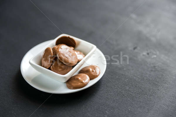 Chocolate candies in porcelain bowl Stock photo © Alex9500