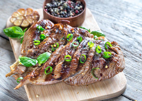 Grilled turkey with green scallion on the wooden board Stock photo © Alex9500