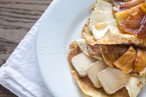 Crepes with brie and caramelized slices of apple Stock photo © Alex9500