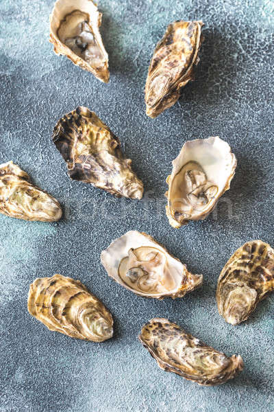 Raw oysters on the gray background Stock photo © Alex9500