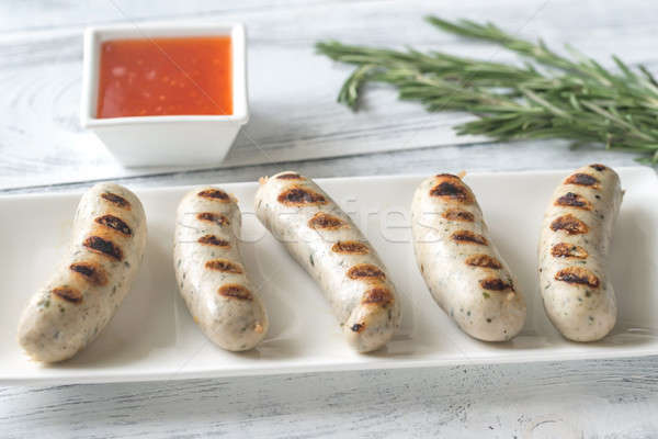 Grilled sausages with sweet chili sauce Stock photo © Alex9500