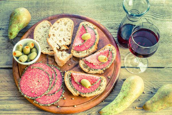 Tranches italien salami poires vin alimentaire Photo stock © Alex9500