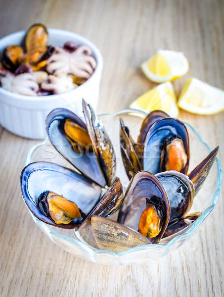 Stock photo: Bowl of mussels on the wooden table