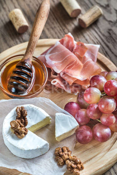 Camembert cheese with nuts and prosciutto Stock photo © Alex9500