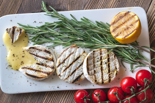 Grilled Camembert cheese with cherry tomatoes and rosemary Stock photo © Alex9500