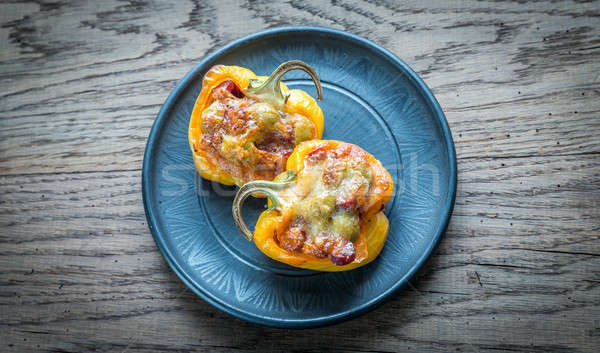 Stuffed peppers with sausages and mozzarella topping Stock photo © Alex9500