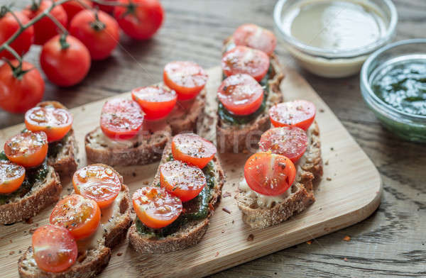 Stock photo: Toasts with tahini and mint sauce and cherry tomatoes