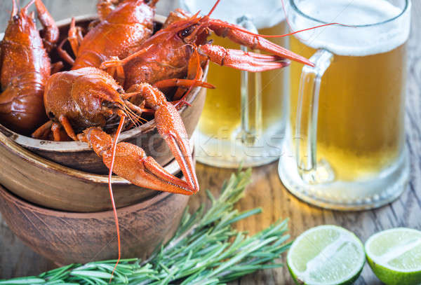 Bowl of boiled crayfish with two mugs of beer Stock photo © Alex9500