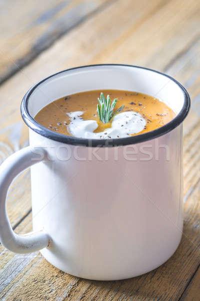 Mug of pumpkin cream soup Stock photo © Alex9500