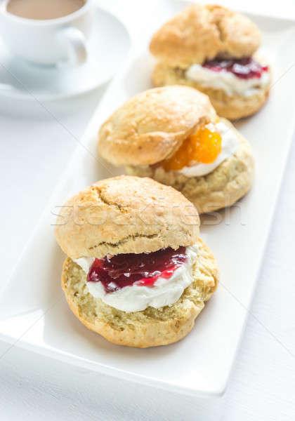Scones with cream and fruit jam Stock photo © Alex9500