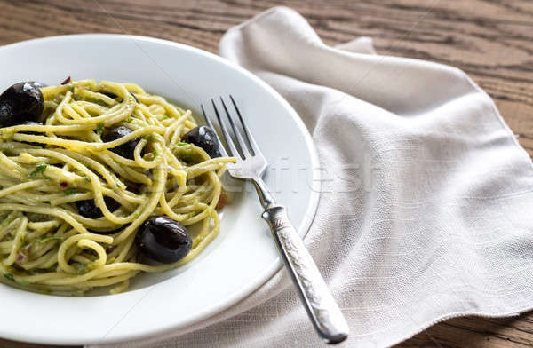 Pasta with guacamole sauce and black olives Stock photo © Alex9500