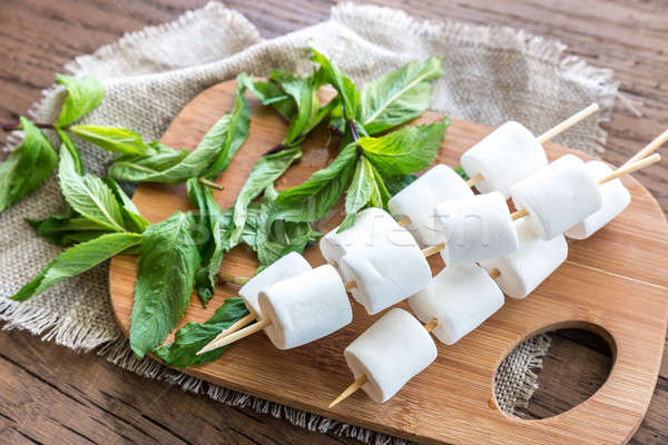 Marshmallow skewers on the wooden board Stock photo © Alex9500