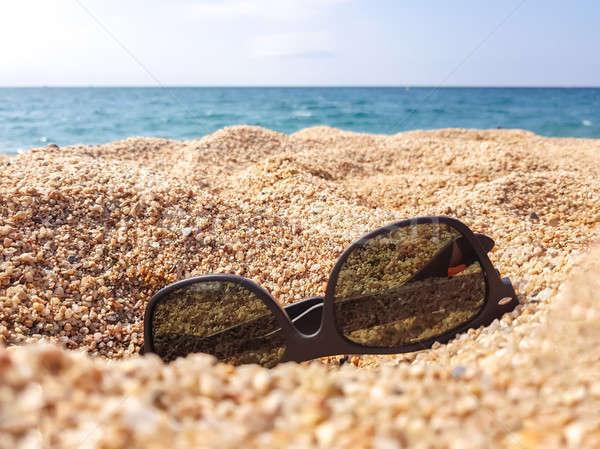 Sunglasses on the sand beach Stock photo © Alex9500
