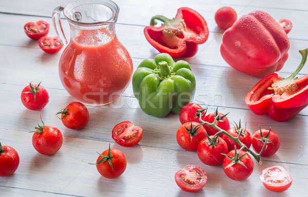 Fresh tomatoes, peppers and jug of juice Stock photo © Alex9500