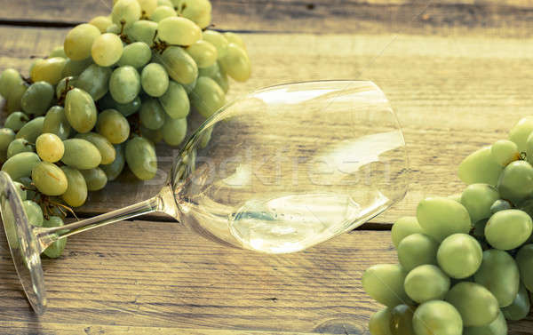 Glass of white wine with bunch of grape Stock photo © Alex9500