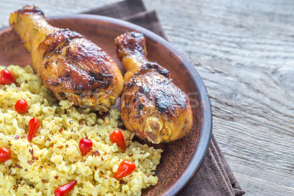 Spicy chicken drumsticks with rice curry Stock photo © Alex9500