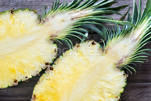 Pineapple on the wooden background: cross section Stock photo © Alex9500