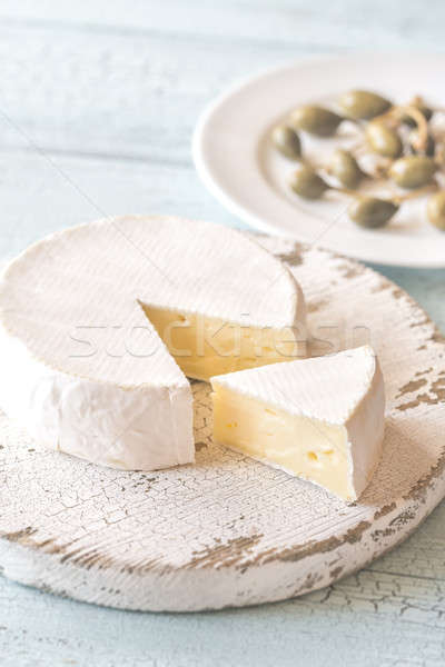 Camembert with capers on the wooden board Stock photo © Alex9500
