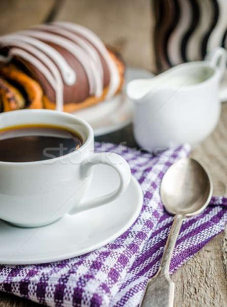 Cup of coffee and poppy bun glazed with ganache Stock photo © Alex9500