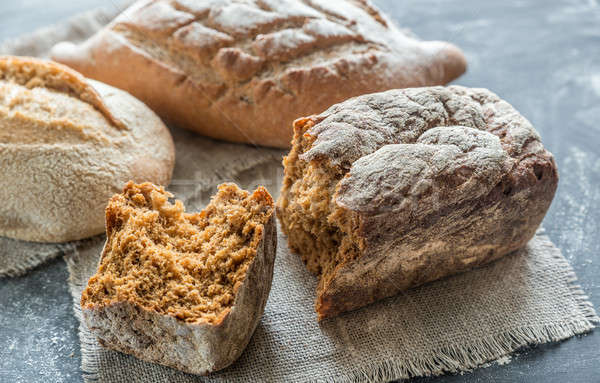 Whole grain breads on the dark wooden background Stock photo © Alex9500