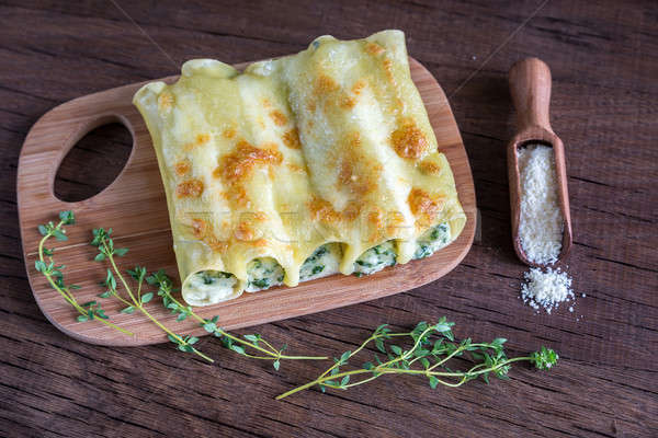 Cannelloni with ricotta and spinach on the wooden board Stock photo © Alex9500