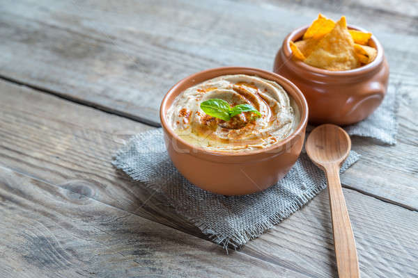Stock photo: A bowl of hummus with corn chips