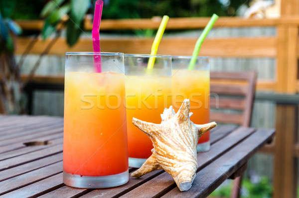 Három tequila napfelkelte koktélok üveg háttér Stock fotó © Alex9500