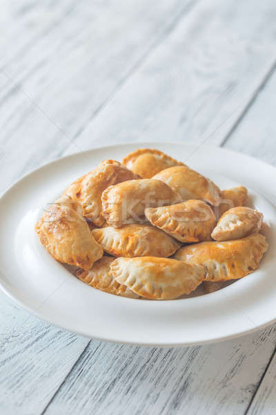 Stock photo: Mini chicken pies on the white plate