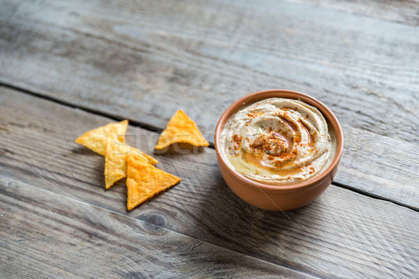 A bowl of hummus with corn chips Stock photo © Alex9500