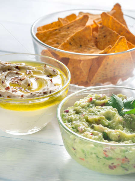 Bowls of hummus and guacamole with tortilla chips Stock photo © Alex9500