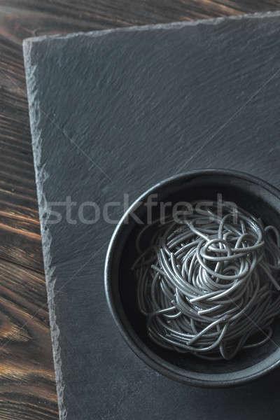 Ciotola pasta calamari inchiostro sfondo cena Foto d'archivio © Alex9500