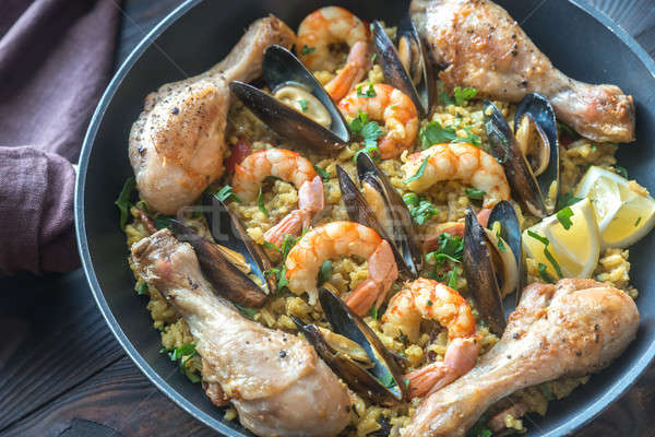 Seafood paella wuth chicken in the pan Stock photo © Alex9500