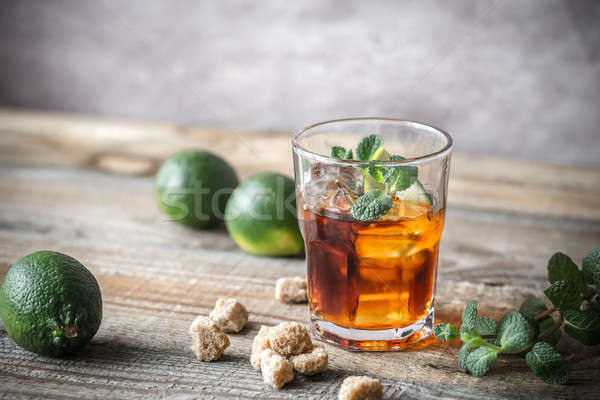 Glass of rum on the wooden background Stock photo © Alex9500