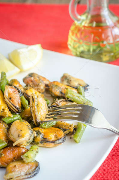 Stock photo: Fried mussels on the square plate