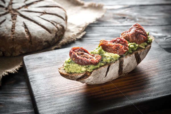Sandwich with guacamole and sun-dried tomatoes Stock photo © Alex9500