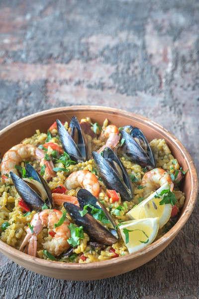 Bowl of seafood paella Stock photo © Alex9500