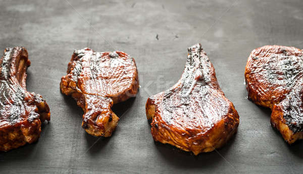 Grilled pork ribs on the wooden background Stock photo © Alex9500
