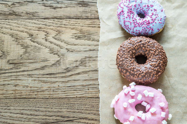 Colourful donuts arranged in a row Stock photo © Alex9500