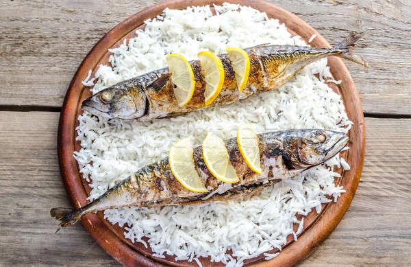 Grilled mackerel with basmati rice and fresh arugula Stock photo © Alex9500