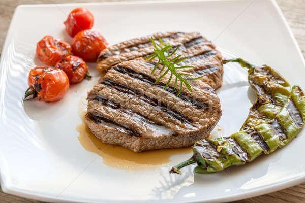 Beef steaks on the white square plate Stock photo © Alex9500