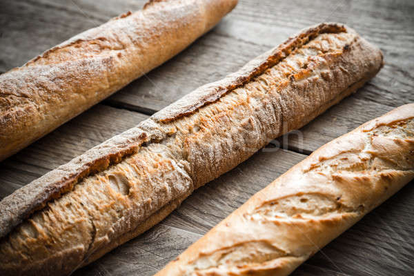 Three baguettes on the wooden background Stock photo © Alex9500