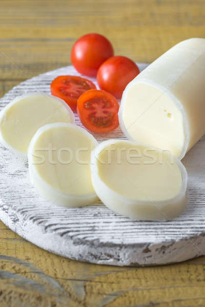 Sliced Formaggio with cherry tomatoes on the wooden board Stock photo © Alex9500