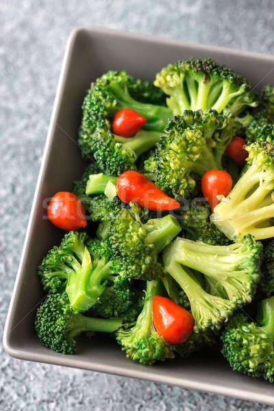 Bowl of broccoli and chili stir-fry Stock photo © Alex9500