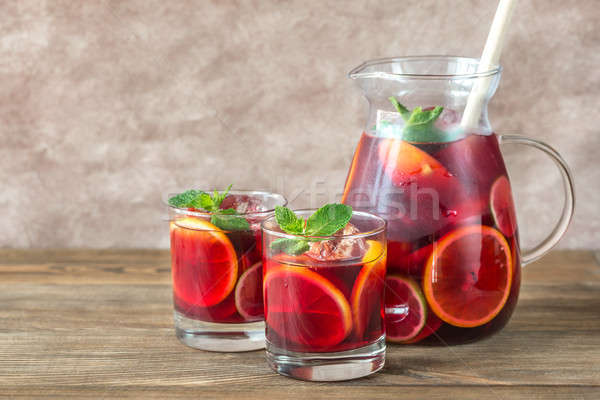 A pitcher and two glasses with Spanish fruit Sangria Stock photo © Alex9500